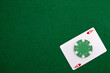 Ace with casino chip on a green casino table with space for text