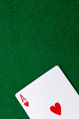 Ace on a green casino table with space for text
