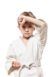 Child boy in kimono training karate