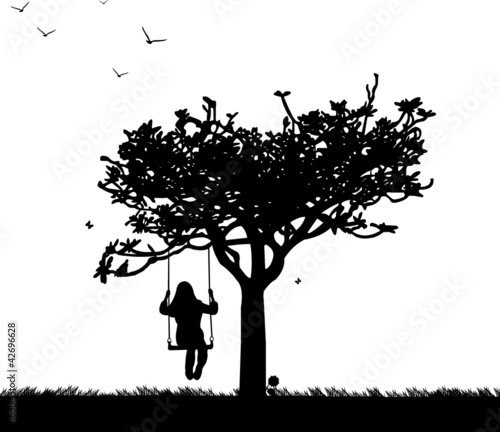 Girl on swing in park or garden silhouette