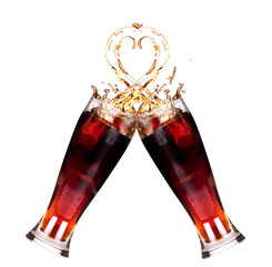 two fresh coke splash in glass making a toast.concept heart