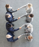 High angle view of business people shaking hands in a row