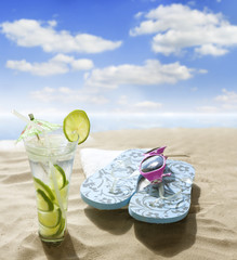 sunglasses drink in sand on beach at sea holiday  concept