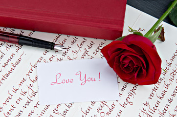 Red rose and love letter