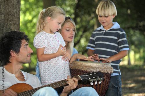 portrait of a family playing music