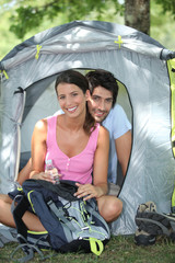 Couple sitting in front of their tent
