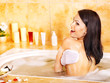 Young woman take bubble  bath.