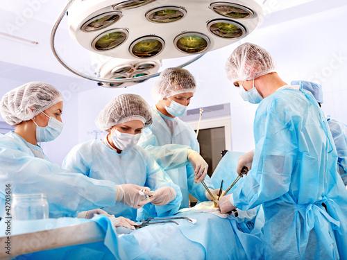 Leinwandbild Motiv Surgeon at work in operating room.