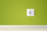 Green wall with european electric outlet
