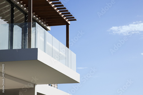 Glass balcony on modern house