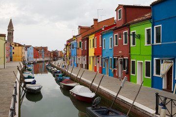 Burano, canal and colourful houses.