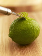 Close up of zester peeling lime