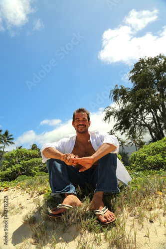 young male smiling tropical setting