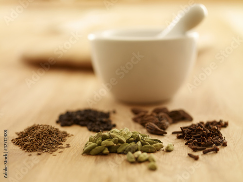 Close up of spices with mortar and pestle