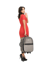 unhappy woman with suitcase waving hand