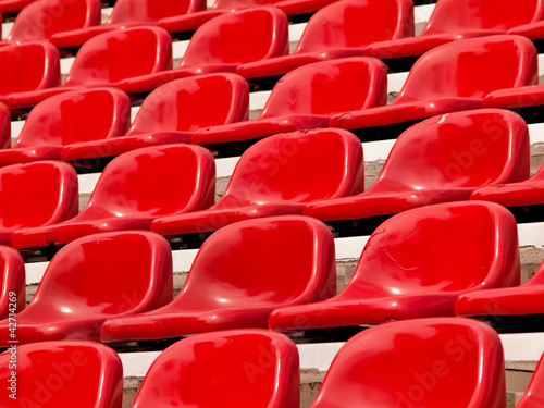 poster of regular red seats in a stadium
