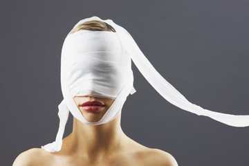 Bandage covering womanís face