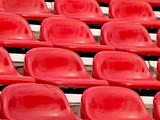 regular red seats in a stadium poster