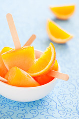Orange ice lollies