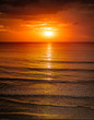 Sunrise in the sea with softwave and cloudy - 42720025