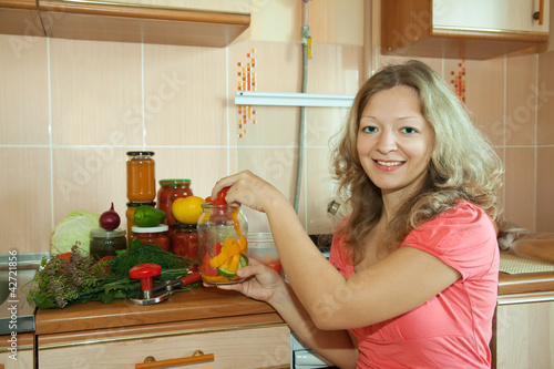 Woman marinating vegetables