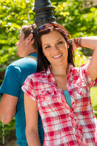 Smiling woman in love posing in park