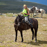 tourist with backpack on horseback