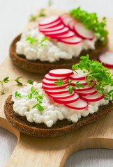 Radish sandwich with watercress salad