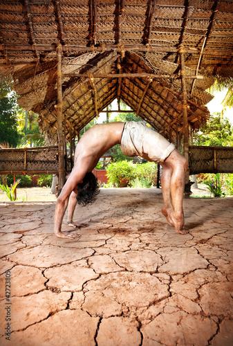 Grunge Yoga Chakrasana