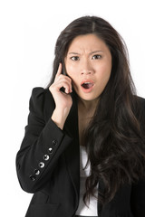 Angry business woman on phone.