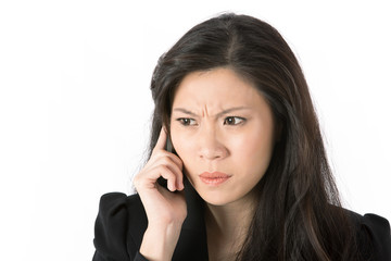 Angry businesswoman talking on smart phone