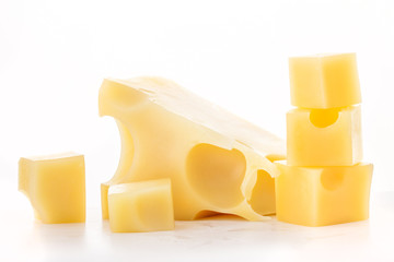 Pieces of cheese isolated on a white background
