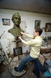 Sculptor works in studio with model of bust of Suvorov