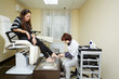Woman in a pedicure room gets a session of foot care.