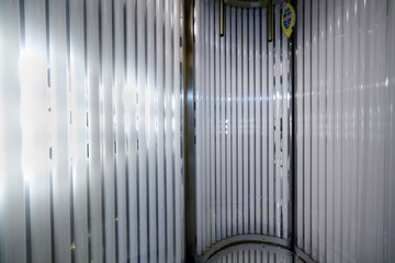 Inside the vertical tanning booth.