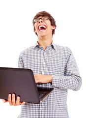 Laughing funny guy with laptop