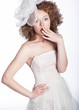 Surpised woman in white wedding dress isolated posing. Studio