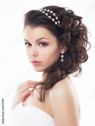 Portrait of beautiful young bride - isolated on white background