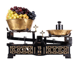 Old-fashioned balance scale with grapes
