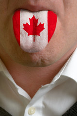 man tongue painted in canada flag symbolizing to knowledge to sp