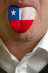 man tongue painted in chile flag symbolizing to knowledge to spe