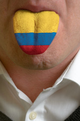 man tongue painted in colombia flag symbolizing to knowledge to