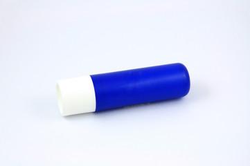 Blue tube of lip balm isolated on white background