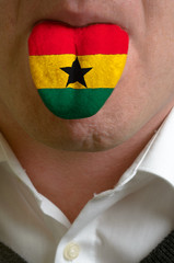 man tongue painted in ghana flag symbolizing to knowledge to spe