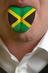 man tongue painted in jamaica flag symbolizing to knowledge to s