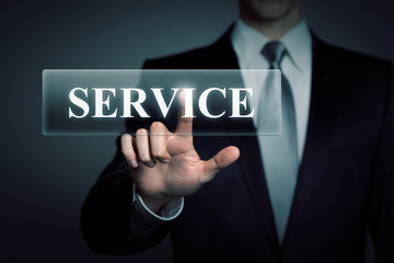 businessman touching virtual SERVICE button