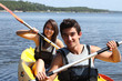 Teenagers kayaking