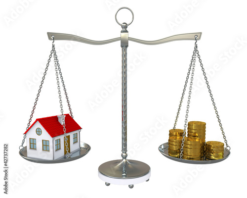 House and gold coins on the scale