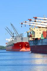 cargo ships loading in cargo terminal