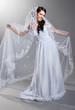 beautiful bride is standing in wedding dress